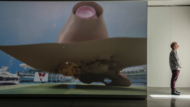 A video exhibition at UTS Gallery shows the crowd's reaction at an AFL game as a 3D graph.