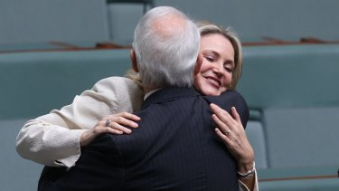 Melissa Parke is embraced by Philip Ruddock after her farewell speech at Parliament House.