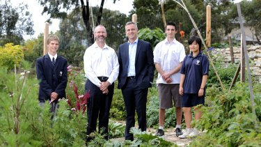 Templestowe College principal Peter Hutton, left, and Swinburne engagement officer Andrew Smith with college students, left to right, Blake Pollock, Liam Evangelista and Bella Park.