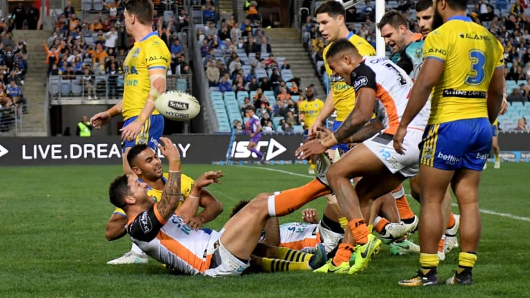 Anything you can do: Malakai celebrates a try for Wests Tigers against Parramatta.