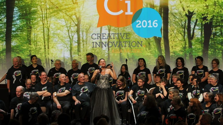 Evangelical approach: Creative Innovation Global's founder, Tania de Jong, sings with Creativity Australia's With One Voice choir at the gala dinner of last year's conference.