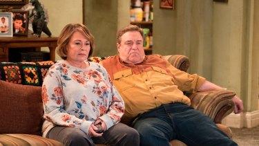 Roseanne Barr, left, and John Goodman appear in a scene from the reboot of Roseanne.