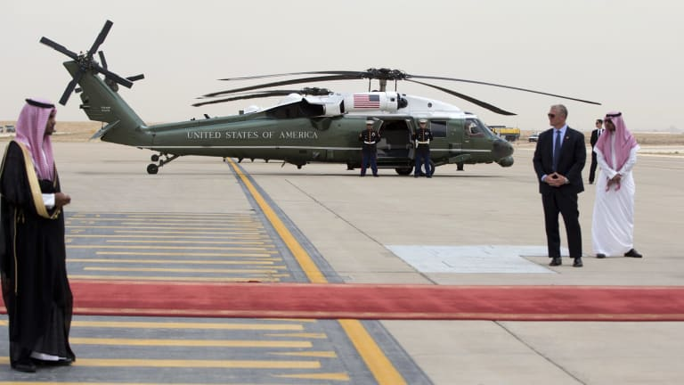 A rockier road: Marine One is staged on the tarmac as President Barack Obama arrives on Air Force One at King Khalid International Airport in Riyadh.