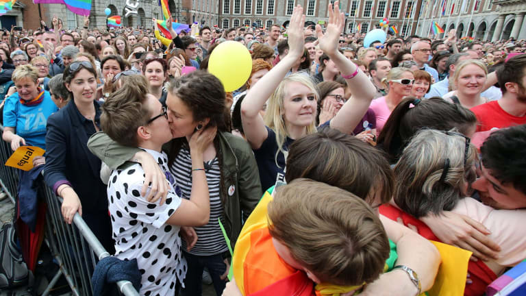 Supporters celebrate outside Dublin Castle following the announcement of the result of the same-sex marriage referendum in Dublin on Saturday.