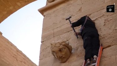 Islamic State extremists at Iraq's ancient city of Hatra destroyed the archaeological site by smashing sledgehammers into its walls and shooting Kalashnikov assault rifles at priceless statues.