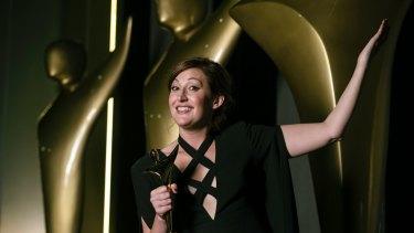 Celia Pacquola celebrates her AACTA Award win.