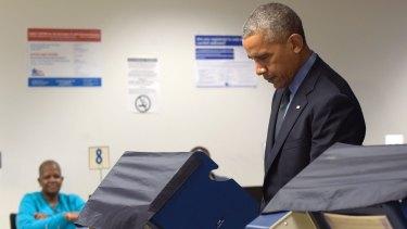 President Barack Obama votes early in Chicago.