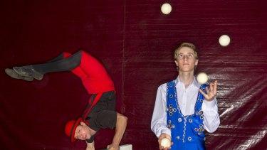 "Mitchel Falagan as ""Miguel the Magnificent"" in a chair balancing act and a juggling Joe Maynard."