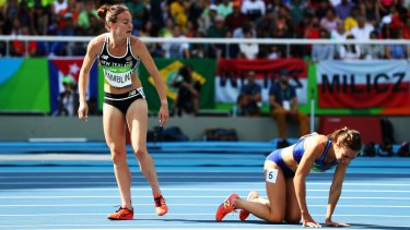Nikki Hamblin, left, looks back after she clipped heels with Abbey D'Agostino.