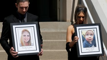 Relatives of the Rozelle blast victims Bianka and Jude O'Brien carry their photographs during their funeral service at St Joseph's Catholic Church.