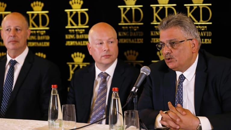 US Middle East envoy Jason Greenblatt, centre, with  Israeli Minister of Regional Cooperation Tzachi Hanegbi, left, and  Palestinian Water Authority head Mazin Ghunaim in Jerusalem on Thursday.