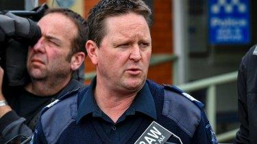 Sergeant Mark Knight addresses the media on Thursday.