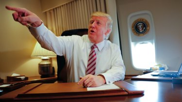 President Donald Trump on Air Force One on Thursday.