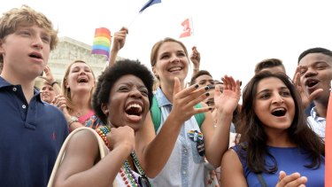 People shout slogans as they celebrate outside the Supreme Court in Washington, DC after its historic decision on gay marriage.