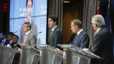 Mr Trudeau speaks during a media conference after the signing.