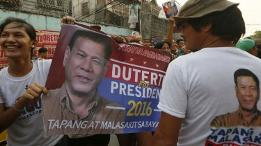 Supporters hold a campaign banner of presidential candidate Mayor Rodrigo Duterte in Manila, the Philippines.