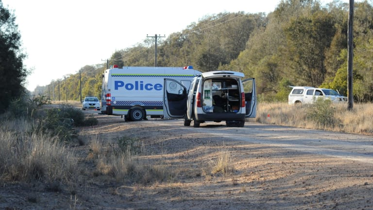 Police block off the road at Talga Lane on the Newell Highway at Croppa Creek after Tuesday's fatal shooting.