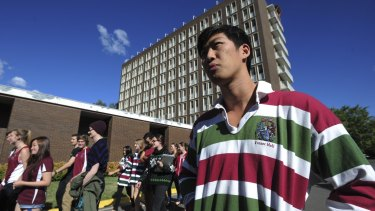 Sean Ding, president of the Fenner Hall Residents Community. He is pictured outside the ageing Fenner Hall ANU residential units on Northbourne Avenue.