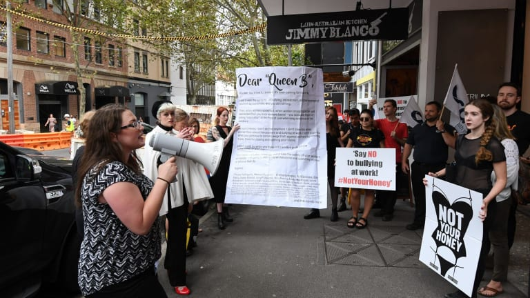 """Claire Boland (with megaphone) from the Young Workers Centre, with former staff and supporters at the protest, the culmination of a """"break up with Honey Birdette"""" boycott campaign that has attracted over 1000 signatures in a week."""