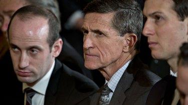 Michael Flynn, former US national security adviser, centre and Jared Kushner, senior White House adviser, right.