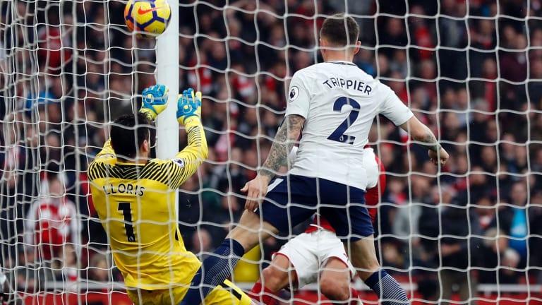 Close range: Arsenal's Alexis Sanchez shoots past Hugo Lloris at Emirates Stadium.