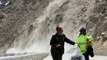 People in Nyalam county in the Tibet Autonomous Region run from a landslide triggered by a tremor following the 7.9-magnitude earthquake that hit the region on Saturday.