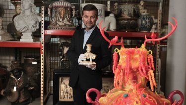 Basement collection: Powerhouse Museum curatorial director Peter Denham with a moulded porcelain elephant vase from England, 1882, and a vase by Kate Rohde, 2016.