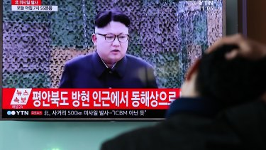 A man in Seoul, South Korea watches a broadcast of Kim Jong-un after North Korea's most recent ballistic missile test.