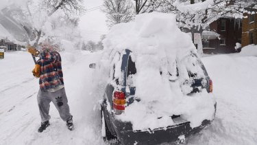 Kevin Deiner of Erie, Pensylvannia, digs out his car on Saturday.