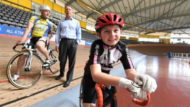 Gabi Forman on the track with cyclist Geoff Stoker and Cycling NSW's Phil Ayres.