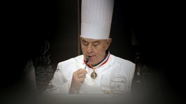 "Paul Bocuse tastes a dish during the ""Bocuse d'Or"" (Golden Bocuse) trophy, at the 14th World Cuisine contest, in Lyon, in 2013."