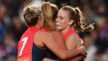 Dee crush: Alyssa Mifsud of the Demons is enjoys a goal with teammates on Saturday night.