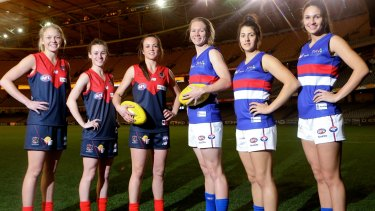 Blazing a trail: Demons and Dogs players before the women's exhibition match in June.