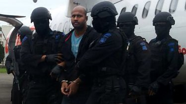 Myuran Sukumaran handcuffed arriving at Cilacap airport.
