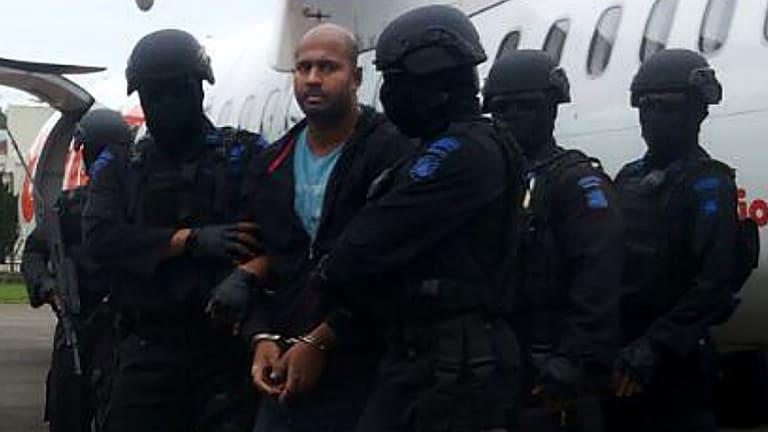 Myuran Sukumaran handcuffed arriving at Cilacap airport.