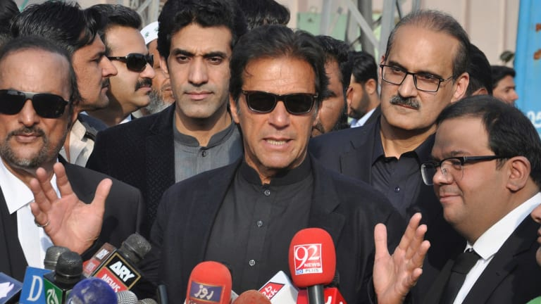 """Former cricketer, now Pakistan's Opposition Leader Imran Khan, centre, said Trump was """"ignorant and ungrateful"""" after the US leader accused Pakistan of harbouring terrorists."""