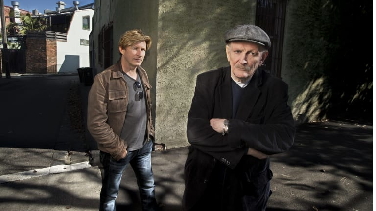 Paul Cox (right), with actor David Wenham, outside his Albert Park office last year.