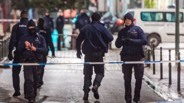 Police close streets near the Grand Place in Brussels in November. Police found material that could be used to make explosives and handmade belts during a raid on a Brussels apartment on December 10.