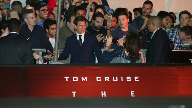 Tom Cruise, mobbed by fans as he arrives for the premiere on Monday night.