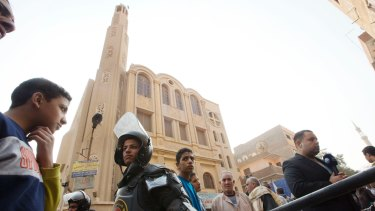 Police surround Mar Mina church, in Helwan, Cairo, Egypt, on December 29.