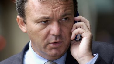 Peter Foster - photographed in 2003 - is accused of defrauding an investor of $1.5 million through a sports betting company.