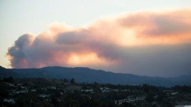 Seen from Carpinteria, California, smoke from a wildfire billows over Ventura.