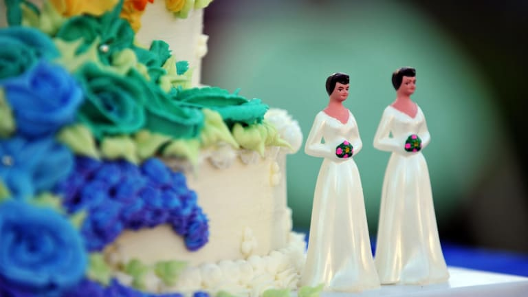 In the US, a baker has been prosecuted for refusing to put a slogan on a wedding cake.
