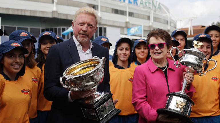 Former champions Boris Becker and Billie Jean King hold the men's and women's trophies ahead of the first round matches on day one of the 2018 Australian Open.