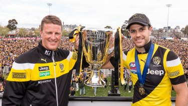 Tigers coach Damien Hardwick and captain Trent Cotchin with the cup at Punt Road Oval.