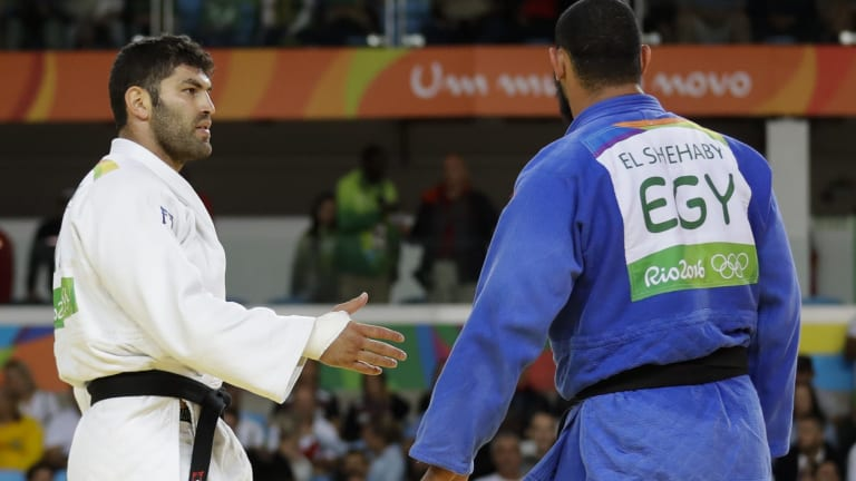 Disrespectful: Egypt's Islam El Shehaby, in blue, declines to shake hands with Israel's Or Sasson after losing during the men's over 100-kg judo competition in Rio on Friday.