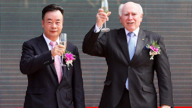 Chau Chak Wing and John Howard share a toast in 2011.
