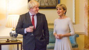 Boris Johnson listens as Julie Bishop speaks at 10 Downing Street on Thursday.