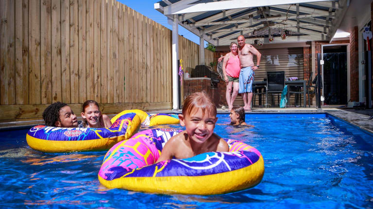 Anna and Peter Tesoriero went over and above safety requirements to ensure their backyard pool was safe for their children. Anna and Peter Tesoriero with Kai, 5, in front. Friend Alizea with Eva, 9, and Zoe, 11 in the middle.