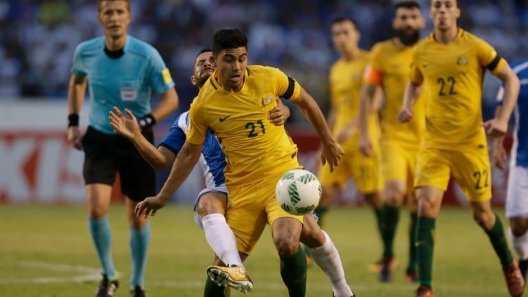 Australia's Massimo Luongo (21) controls the ball ahead of Honduras' Alfredo Mejia at the Olympic Stadium in San Pedro Sula.